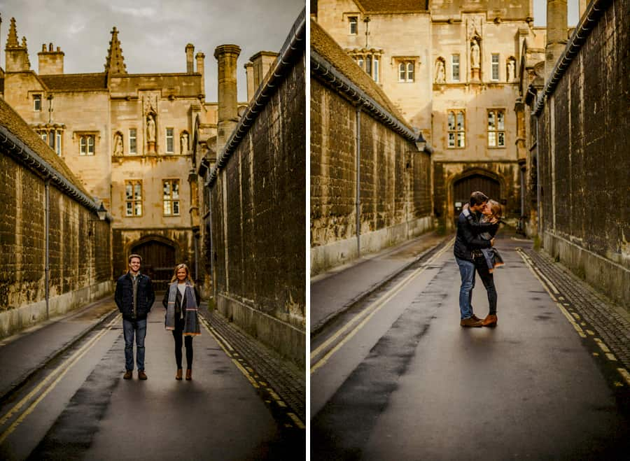A man and lady stand in the middle of a street in Oxford and pose for a photographs